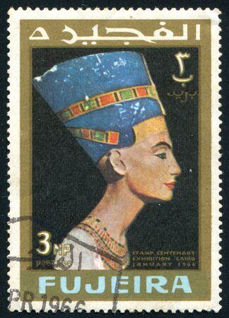 FUJEIRA - CIRCA 1966: stamp printed by Fujeira, shows Head staue of egyptian queen Cleopatra. , circa 1966