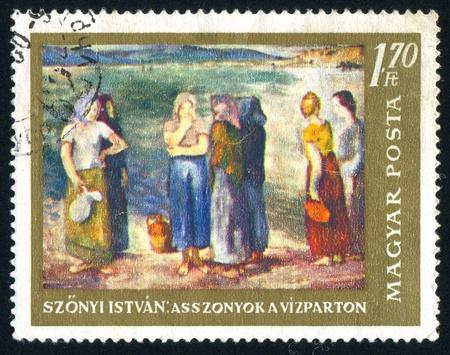HUNGARY - CIRCA 1967: stamp printed by Hungary, shows Women at the River Bank by Istvan Szonyi, circa 1967 photo