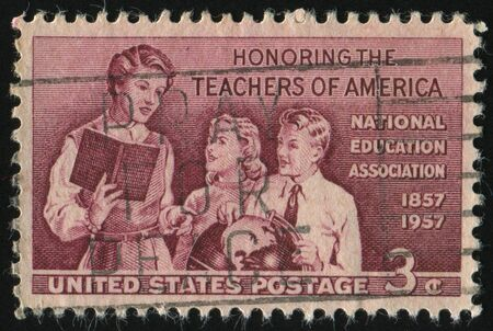 UNITED STATES - CIRCA 1957: stamp printed by United states, shows  Teacher and Pupils, circa 1957. Stock Photo - 8997915
