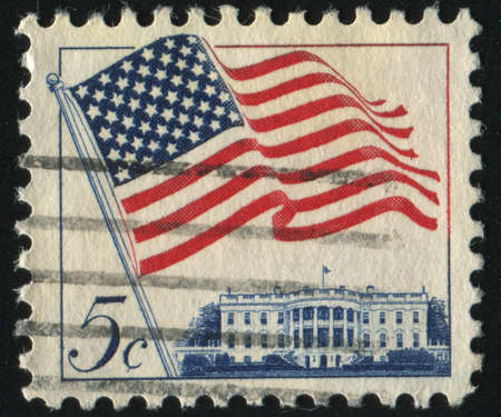 red stamp: UNITED STATES - CIRCA 1962: stamp printed by United states, shows Flag over White House, circa 1962.