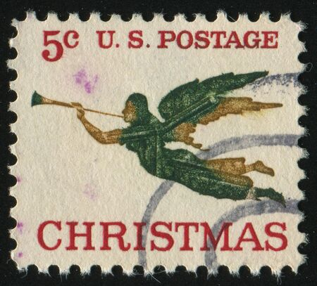UNITED STATES - CIRCA 1965: stamp printed by United states, shows Angel with Trumpet, circa 1965. photo
