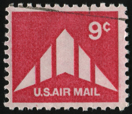 UNITED STATES - CIRCA 1969: stamp printed by United states, shows Silhouette of Delta Wing Plane, circa 1969. photo