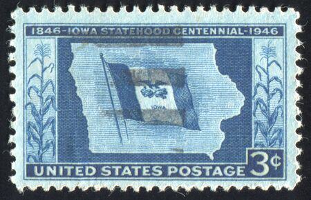 UNITED STATES - CIRCA 1946: stamp printed by United states, shows Iowa State Flag and Map, circa 1946 photo
