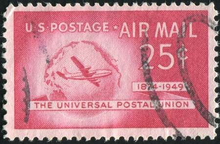UNITED STATES - CIRCA 1949: stamp printed by United states, Boeing Stratocruiser and Globe, circa 1949 photo