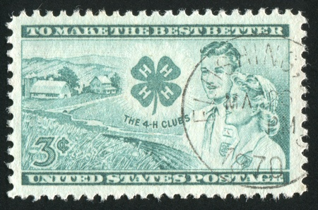 UNITED STATES - CIRCA 1952: stamp printed by United states, shows Farm, Club Emblem, Boy and Girl, circa 1952 Stock Photo - 9011922