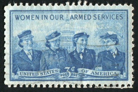 corps: UNITED STATES - CIRCA 1952: stamp printed by United states, shows Women of the Marine Corps, Army, Navy and Air Force, circa 1952 Editorial