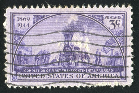 UNITED STATES - CIRCA 1944: stamp printed by United states, shows Golden Spike Ceremony� Painting by John McQuarrie, circa 1944 photo