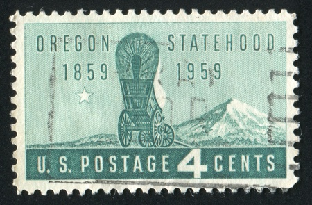 covered wagon: UNITED STATES - CIRCA 1959: stamp printed by United states, shows Covered Wagon and Mt. Hood, circa 1959