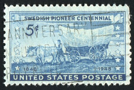 covered wagon: UNITED STATES - CIRCA 1948: stamp printed by United states, shows Swedish Pioneer with Covered Wagon Moving Westward, circa 1948 Stock Photo