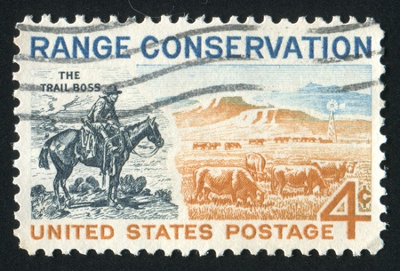 circa: UNITED STATES - CIRCA 1961: stamp printed by United states, shows The Trail Boss and Modern Range, circa 1961