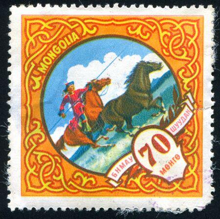 mongolia horse: MONGOLIA - CIRCA 1959: stamp printed by Mongolia, shows Hunting wild horse, circa 1959.