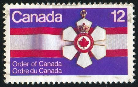 CANADA - CIRCA 1977: stamp printed by Canada, shows Order of Canada, circa 1977 Stock Photo - 9463768