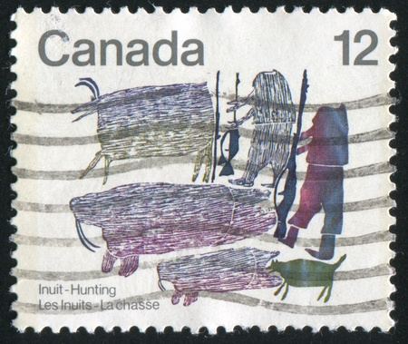 inuit: CANADA - CIRCA 1977: stamp printed by Canada, shows Inuit hunting, circa 1977 Stock Photo