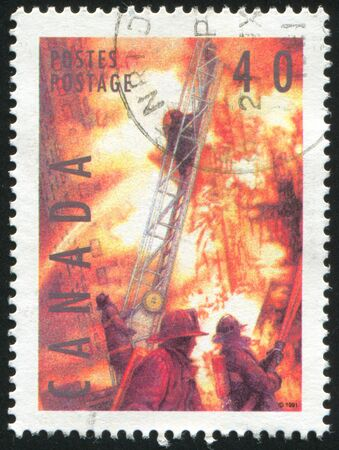 CANADA - CIRCA 1991: stamp printed by Canada, shows Fire fighters, circa 1991 photo