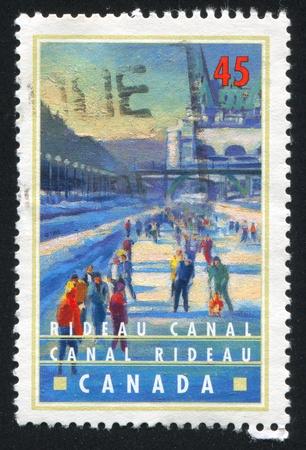 CANADA - CIRCA 1998: stamp printed by Canada, shows Ice skating on Rideau Canal, Ottawa, circa 1998 photo