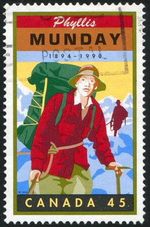 community service: CANADA - CIRCA 1998: stamp printed by Canada, shows Phyllis Munday (1894-1990), mountaineer, community service worker, circa 1998