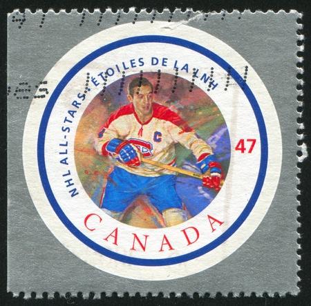 CANADA - CIRCA 2001: stamp printed by Canada, shows hockey player, circa 2001