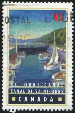 ours: CANADA - CIRCA 1998: stamp printed by Canada, shows Canals of Canada, St. Ours Canal, Quebec, circa 1998