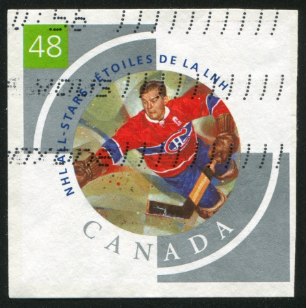 CANADA - CIRCA 2003: stamp printed by Canada, shows hockey player, circa 2003 Stock Photo - 9630441