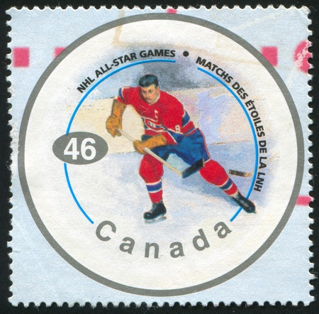 CANADA - CIRCA 2000: stamp printed by Canada, shows hockey player, circa 2000 Stock Photo - 9674907