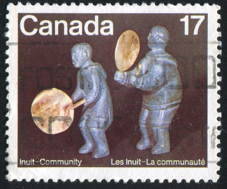 soapstone: CANADA - CIRCA 1979: stamp printed by Canada, shows Two soapstone figures from Repulse Bay, by Madeleine Isserkut and Jean Mapsalak, circa 1979