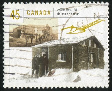 settler: CANADA - CIRCA 1998: stamp printed by Canada, shows Housing in Canada, settler, circa 1998