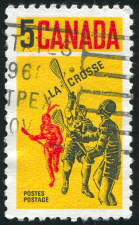 canada stamp: CANADA - CIRCA 1968: stamp printed by Canada, shows Contemporary and Indian Lacrosse Players, circa 1968