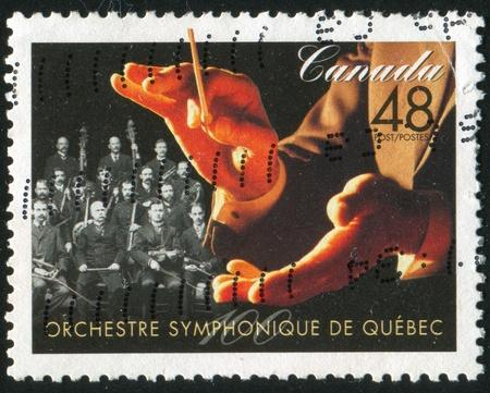 CANADA - CIRCA 2002: stamp printed by Canada, shows Quebec Symphony Orchestra, circa 2002 photo