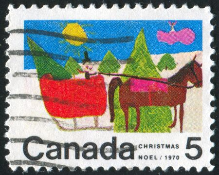 CANADA - CIRCA 1970: stamp printed by Canada, shows Christmas: Designs by Canadian School Children, Horse-drawn Sleigh, circa 1970 photo