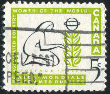 tending: CANADA - CIRCA 1959: stamp printed by Canada, shows Woman Tending Tree, circa 1959 Stock Photo