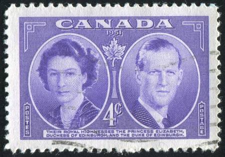 CANADA - CIRCA 1951: stamp printed by Canada, shows Princess Elizabeth and Duke of Edinburgh, circa 1951 Stock Photo - 9742639