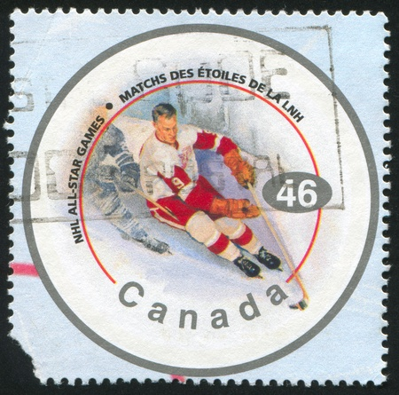 CANADA - CIRCA 2002: stamp printed by Canada, shows hockey player, circa 2002