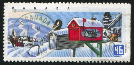 goose head: CANADA - CIRCA 2000: stamp printed by Canada, shows Decorated Rural Mailboxes, Goose head, house designs,  circa 2000 Stock Photo