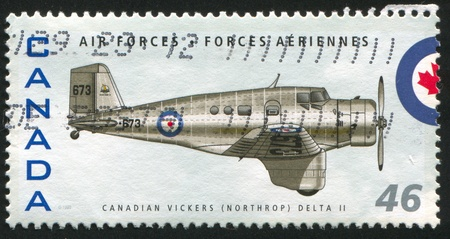 vickers: CANADA - CIRCA 1999: stamp printed by Canada, shows aeroplane, Canadian Vickers (Northrop) Delta II, circa 1999 Stock Photo