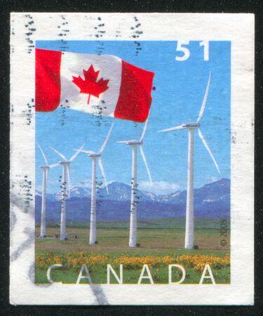 pincher: CANADA - CIRCA 2005: stamp printed by Canada, shows Flag and windmills, Pincher, Creek Alberta, circa 2005 Stock Photo