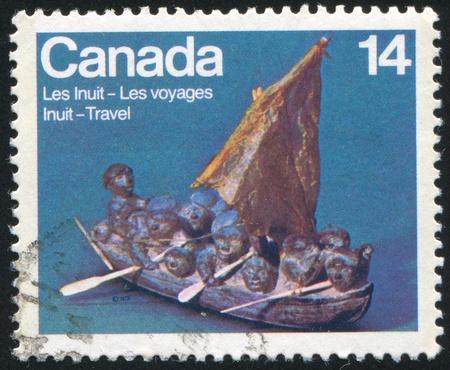 CANADA - CIRCA 1978: stamp printed by Canada, shows Migration, Soapstone by Joe Talurinili, circa 1978 Stock Photo - 9834424