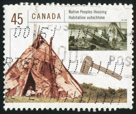 CANADA - CIRCA 1998: stamp printed by Canada, shows Native Poeples Housing, circa 1998 photo