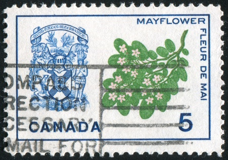 mayflower: CANADA - CIRCA 1965: stamp printed by Canada, shows Mayflower and arms of Nova Scotia, circa 1965 Stock Photo