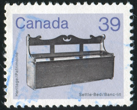 settle back: CANADA - CIRCA 1985: stamp printed by Canada, shows Settle-bed, circa 1985 Stock Photo