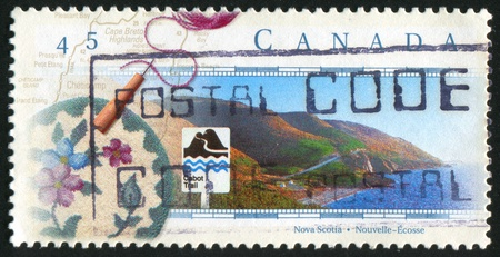 CANADA - CIRCA 1997: stamp printed by Canada, shows The Cabot Trail, Nova Scotia, circa 1997 photo
