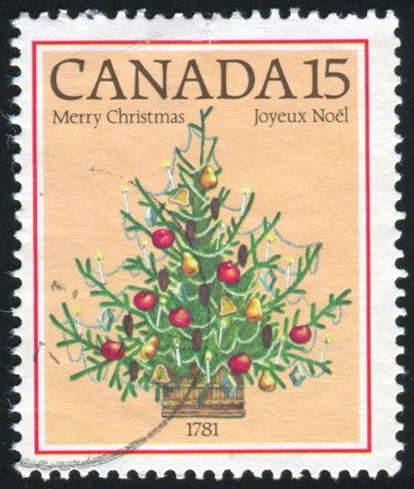 CANADA - CIRCA 1981: stamp printed by Canada, shows Christmas, bicentenary of 1st illuminated Christmas tree in Canada, 1781, circa 1981 photo