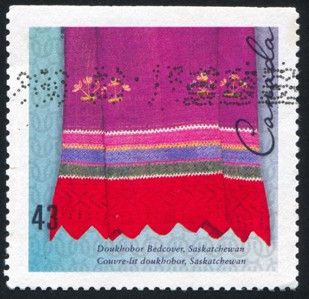 bedcover: CANADA - CIRCA 1993: stamp printed by Canada, shows Doukhobor bedcover, Saskatchewan, circa 1993