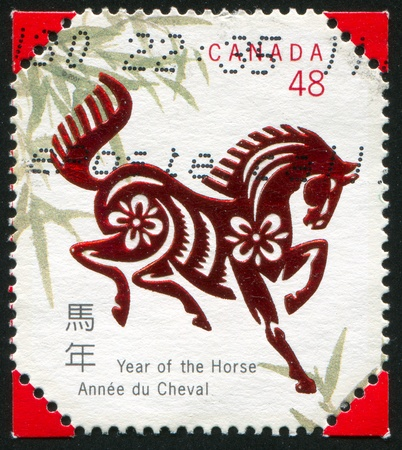 year profile: CANADA - CIRCA 2002: stamp printed by Canada, shows Horse and Bamboo Leaves, circa 2002