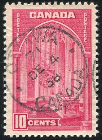 window seal: CANADA - CIRCA 1938: stamp printed by Canada, shows Memorial Chamber, Parliament Building, Ottawa, circa 1938 Stock Photo