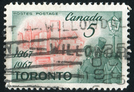 window seal: CANADA - CIRCA 1967: stamp printed by Canada, shows Toronto in 1967 and Citizens of 1867, circa 1967 Stock Photo