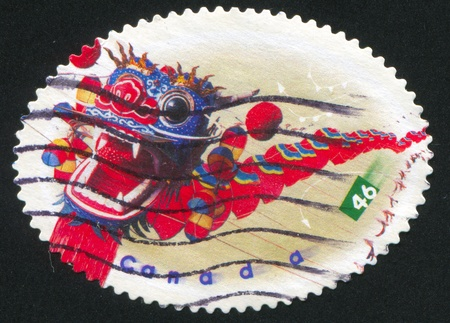 wei: CANADA - CIRCA 1999: stamp printed by Canada, shows Dragon centipede kite by Zhang tian Wei (oval), circa 1999 Stock Photo