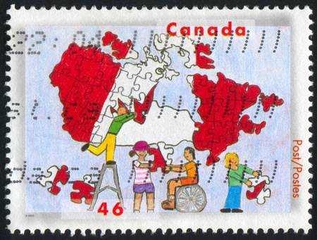 CANADA - CIRCA 2000: stamp printed by Canada, shows Stampin the Future Children's Stamp Design Contest Winners, Children and map of Canada, by Christine Weera, circa 2000 photo