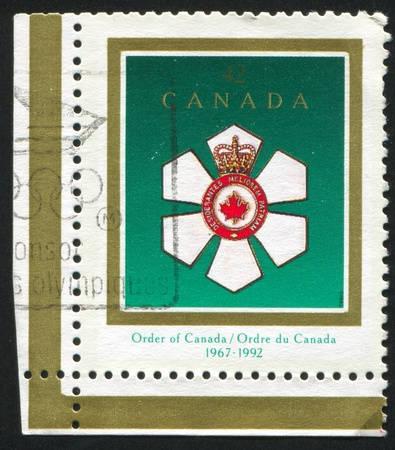 CANADA - CIRCA 1992: stamp printed by Canada, shows Order of Canada, 25th Anniv., circa 1992 Stock Photo - 9957550