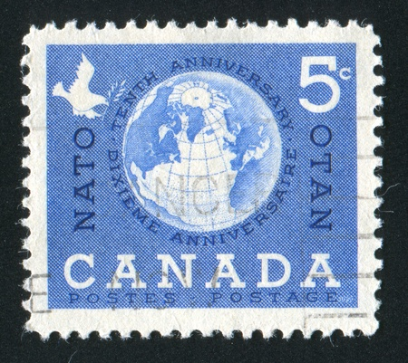 canada stamp: CANADA - CIRCA 1959: stamp printed by Canada, shows Globe and Dove, circa 1959 Stock Photo