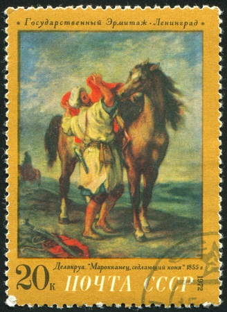 RUSSIA - CIRCA 1972: stamp printed by Russia, shows Moroccan Saddling Steed, Delacroix, circa 1972 Stock Photo - 9957176